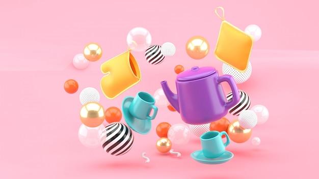 Um jogo de chá entre bolas coloridas em um espaço rosa