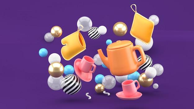 Um jogo de chá entre bolas coloridas em um espaço roxo