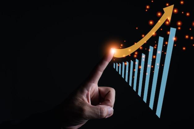 Um lado esquerdo toca o gráfico de negócios do computador gráfico, o crescimento econômico e o fundo escuro do conceito de finanças