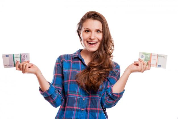 Um, mulher jovem, com, dólares, em, dela, mãos, isolado, branco, fundo