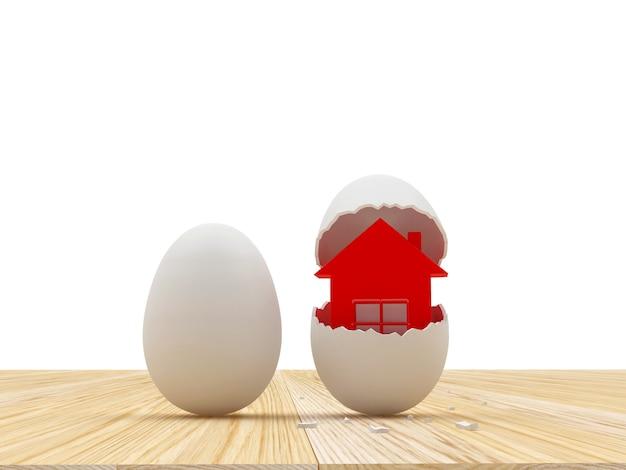 Um ovo inteiro e casca de ovo quebrada com casa