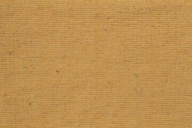 Um padrão de tecido antigo vintage e texturas de fundo do grunge. tecido rústico amarelo de fundo e textura. fechar-se