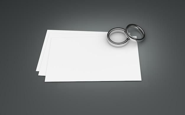 Um par de anéis de prata em papel branco. ilustração 3d