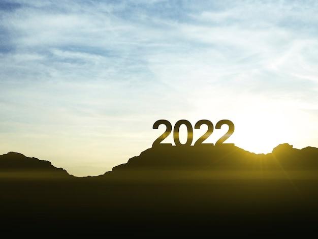 Um sinal de feliz ano novo de 2022 no topo da montanha com o pôr do sol, símbolo de novos sucessos e oportunidades