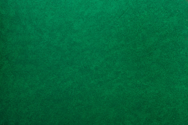 Um velho papel verde texturizado fundo