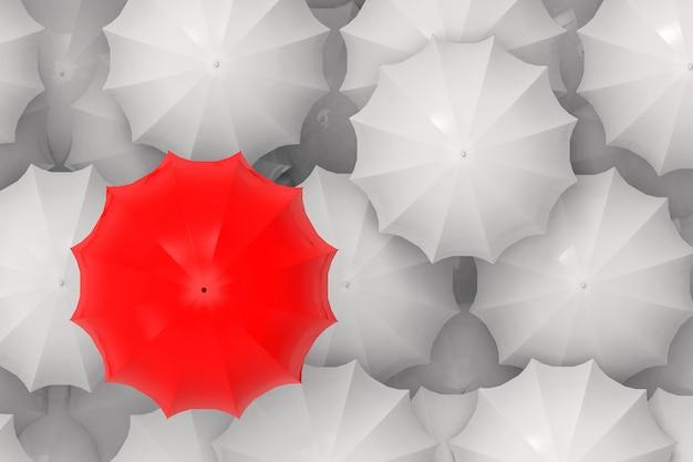 Um vermelho pendente em outros guarda-chuvas brancos.