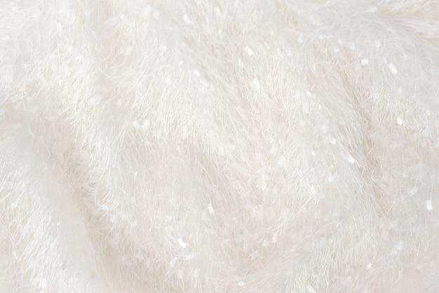 Um vestido xadrez macio e aconchegante de veludo, com um longo tecido de pelo. a textura do tecido branco desgrenhado com uma pilha, uniformemente espalhada.