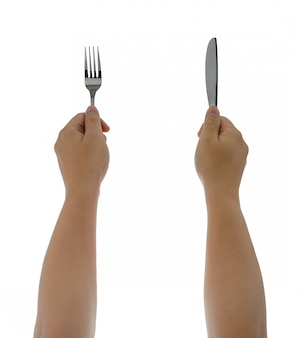 Uma faca e garfo sendo realizada pelas mãos do homem. isolado