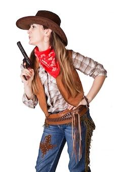 Uma foto isolada de uma cowgirl com uma arma
