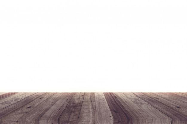 Uma imagem de uma mesa de madeira na frente de um fundo abstrato do branco.