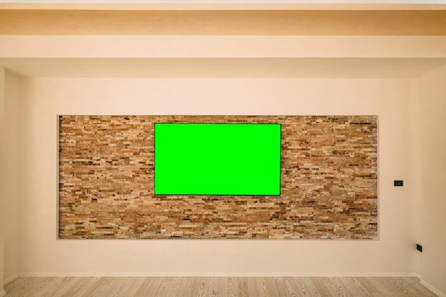Uma moderna tv lcd com tela verde pendurada