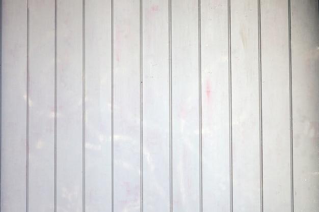 Uma parede de madeira cinza com textura de fundo de madeira pintada de close up ou madeira