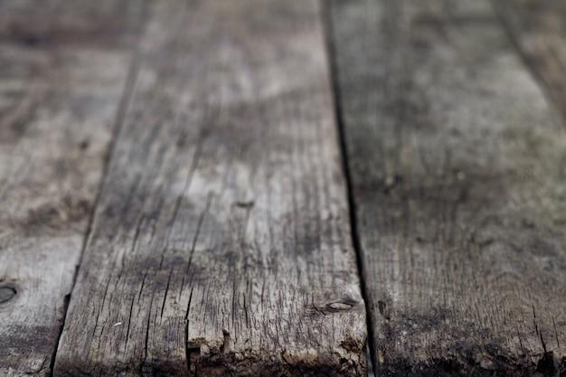 Uma parede de madeira velha, assoalho de madeira do marrom escuro, fundo de madeira marrom velho.