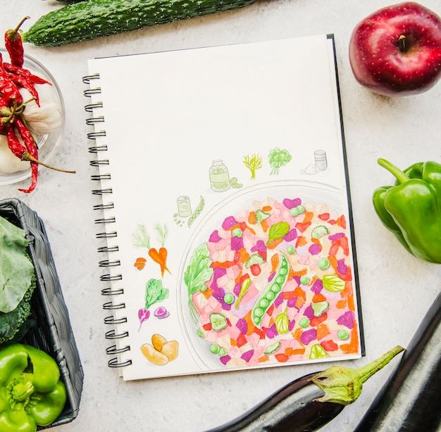Uma visão aérea de um vegetal e livro de receitas