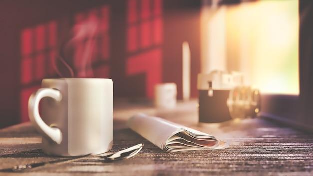 Uma xícara de café e jornal na mesa de madeira velha na luz solar da manhã.