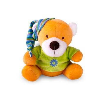 Urso de brinquedo na tampa isolado