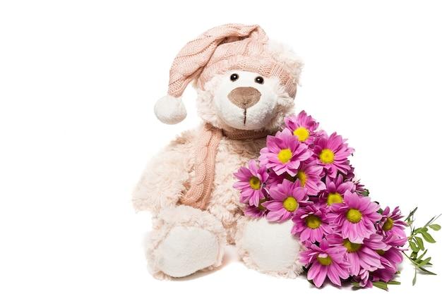 Urso de pelúcia com flores