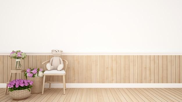 Urso de pelúcia na cadeira na sala de criança ou berçário