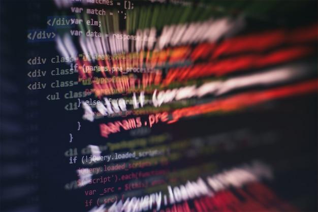 Uso de css, javascript e html. monitore o close up do código-fonte da função. abstrato base de tecnologia de ti. código-fonte do software.