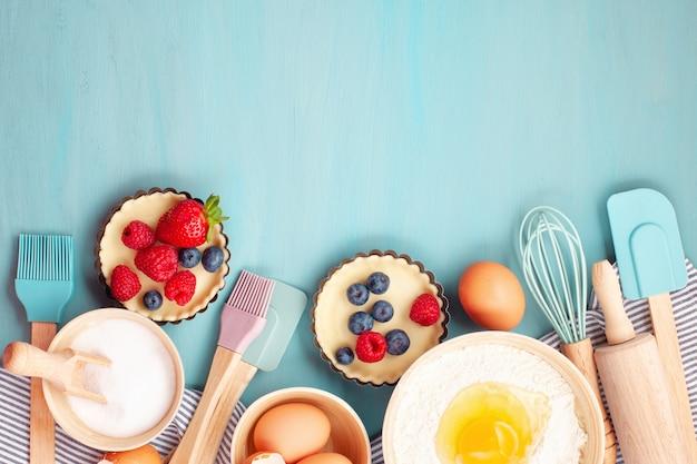 Utensílios de cozimento e ingredientes de cozinha para o blog.