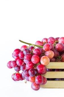Uvas em caixas de madeira