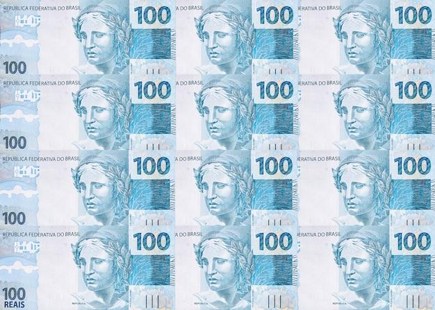 Várias notas de cem reais do brasil, textura de dinheiro brasileiro, notas de superfície de reais