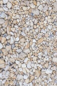Variedade de fundo de seixos de rio. textura com muitas pequenas pedras redondas.
