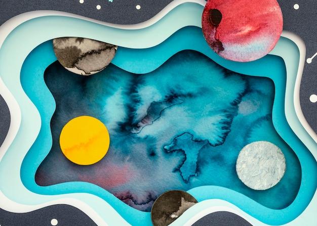 Variedade de planetas de papel criativos de vista superior