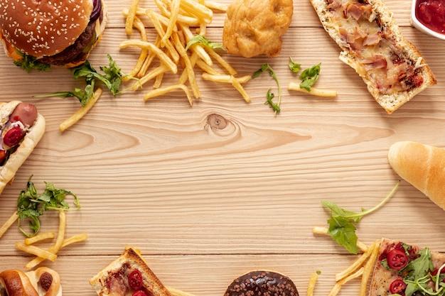 Variedade de vista superior com moldura de comida e espaço para texto