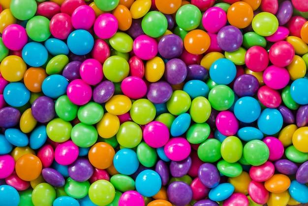 Vário fundo de doces açucarados coloridos