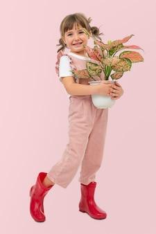 Vasos de plantas e fotos de estúdio infantil
