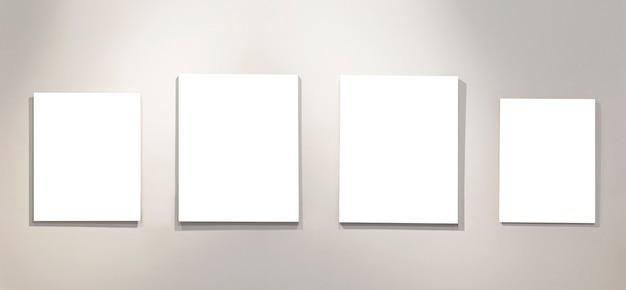 Vazio quatro isolado nas pinturas brancas na parede com iluminação da galeria. espaço para texto.