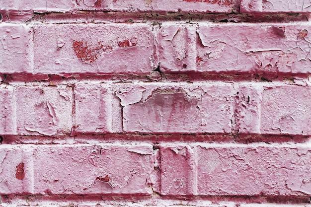 Velha parede de tijolos empoeirada com textura de pintura descascada