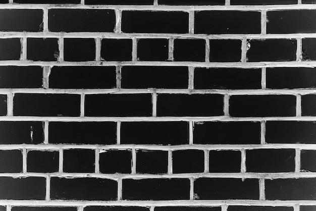 Velha parede de tijolos realista feita de tijolo preto em diferentes shads