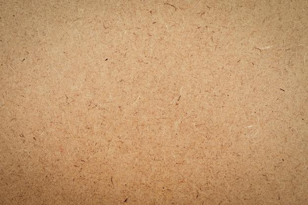 Velho da textura da caixa de papel ofício marrom para o fundo