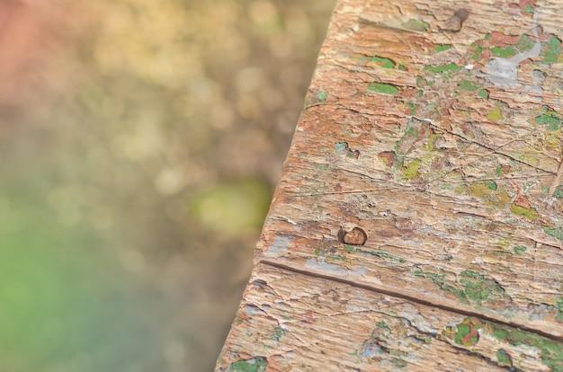 Velho de madeira rachado fundo rústico pintado