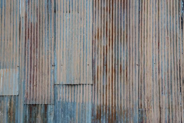 Velho e ferro enferrujado galvanizar placa na textura de casa pobre e cor de tempo passado