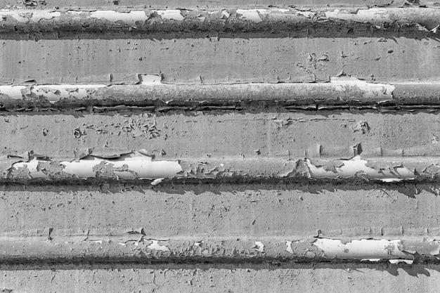 Velho enferrujado rachado pintura fundo textura close-up preto e branco