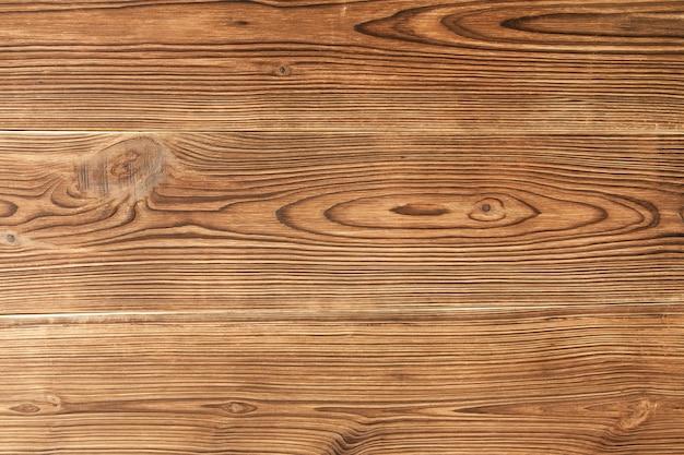 Velho marrom queimado fundo de madeira