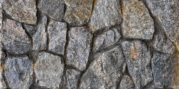 Velho muro de pedra natural. fundo abstrato