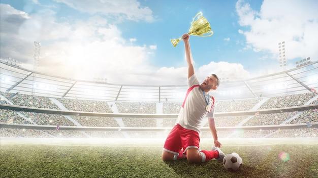 Vencedora. jogador de futebol segura um troféu uma mão