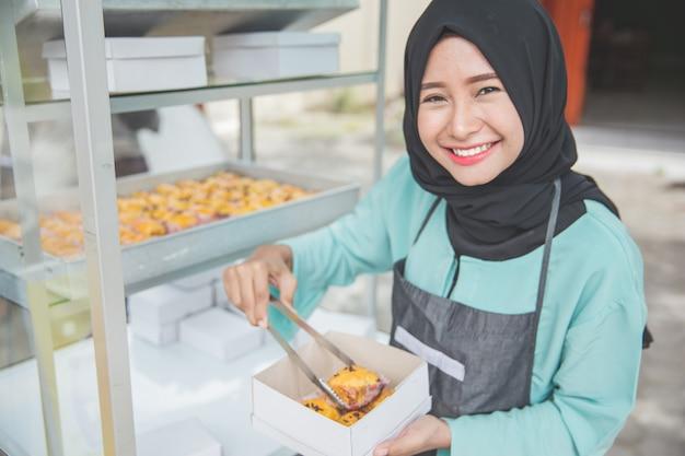 Vendedor de comida de rua muçulmana