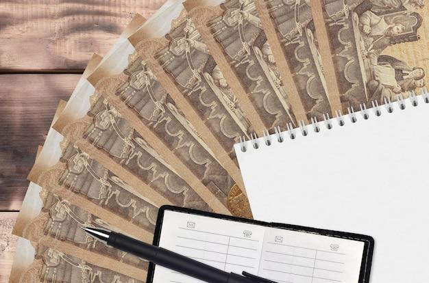 Ventilador de notas de forinto húngaro e bloco de notas com livro de contatos e caneta preta