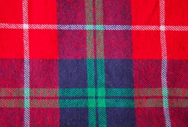 Vermelho quadriculado para o projeto. véspera de ano novo. moda de natal. fechar-se.