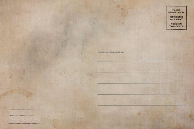 Verso de cartão postal antigo com manchas de sujeira