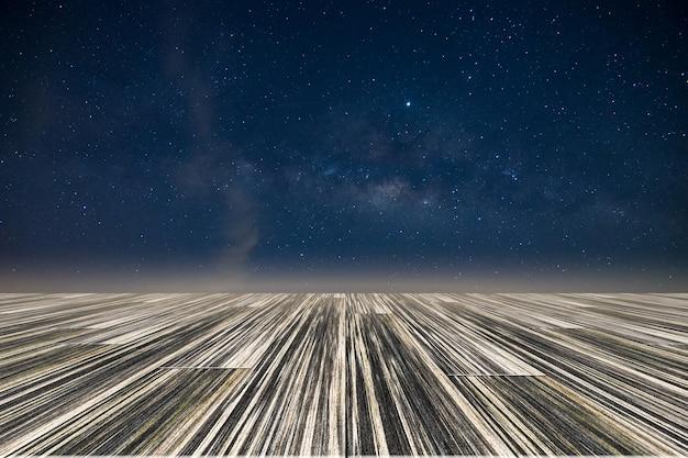 Via láctea estrela galáxia céu noite backglound com piso de madeira