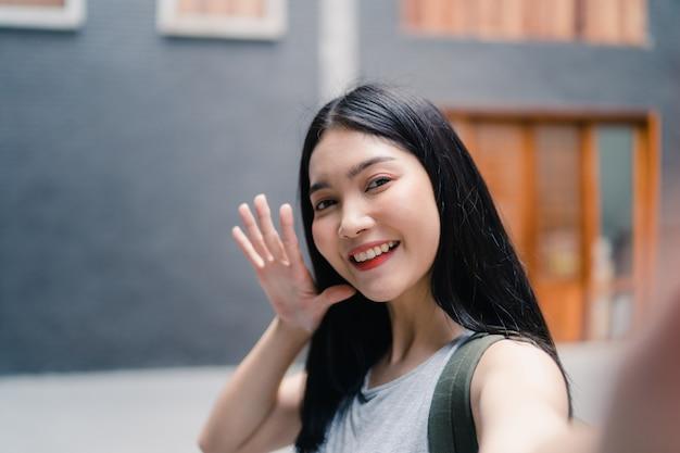 Viagem de mulher blogueiro asiáticos em pequim, china