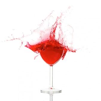 Vidro quebrado com respingo de vinho
