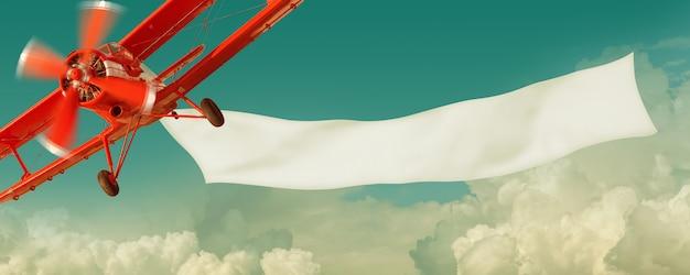 Vintage avião vermelho voando no céu com uma bandeira branca em branco