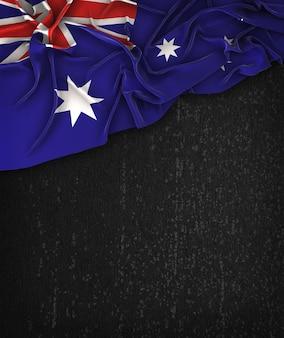 Vintage da bandeira de austrália em um quadro preto do grunge com espaço para o texto